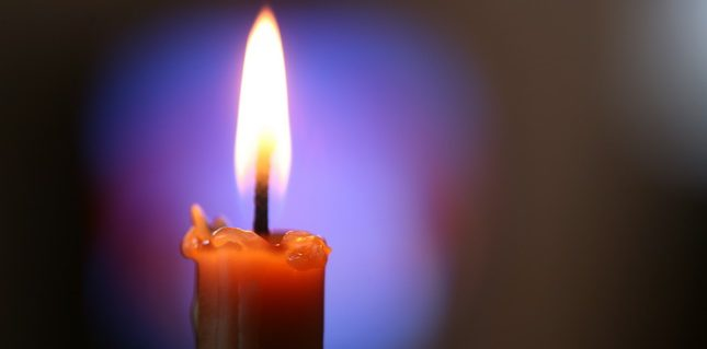 candle in a dark colored background